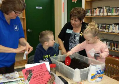 Family planting at local library, K. Smyth